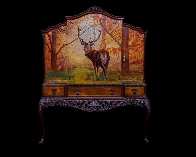 Stag in the woods on 1920's cocktail cabinet